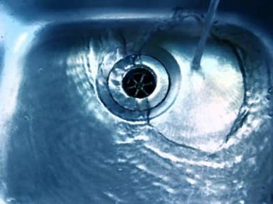 A sink with water draining